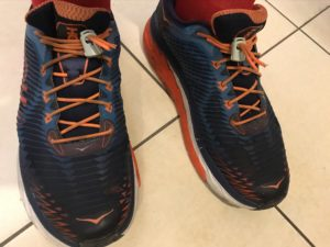 Shoes with orange elastic laces