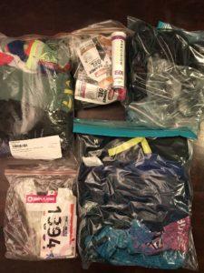five ziplock bags full of tri gear