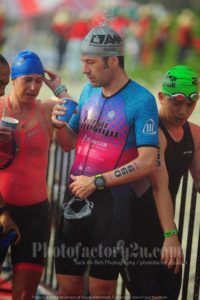 triathlete looking in drink cup after swim