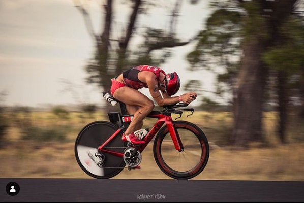 Pro triathlete Tim Reed getting very aero on his bike